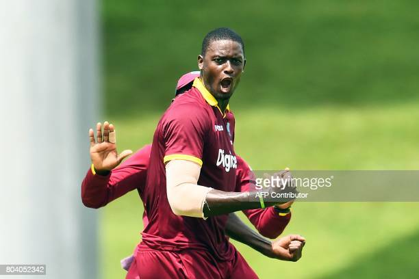 West Indies' captain Jason Holder celebrates after dismissing India's captain Virat Kohli during the third One Day International match between West...