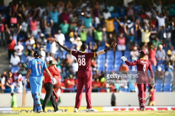 West Indies' captain Jason Holder celebrates their win at the end of the fourth One Day International match between West Indies and India at the Sir...