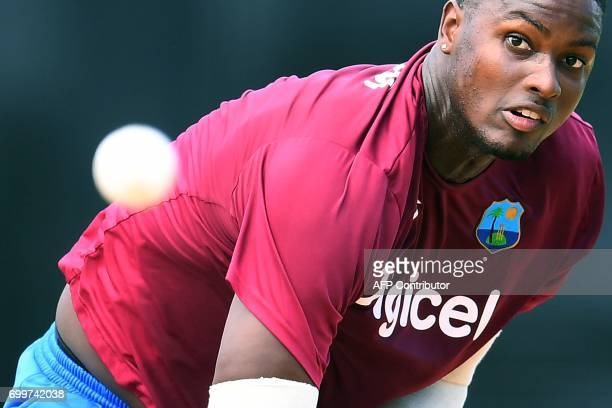 TOPSHOT West Indies' captain Jason Holder delivers a ball during a practice session at the Queen's Park Oval in Port of Spain Trinidad on June 22...