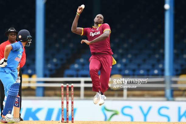West Indies' captain Jason Holder delivers a ball during the second One Day International match between West Indies and India at the Queen's Park...