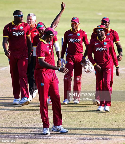 West Indies captain Jason Holder gives his players a thumb up after defeating Sri Lanka during the second One Day International cricket match between...