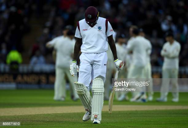 West Indies captain Jason Holder leaves the field after being dismissed by Stuart Broad of England during day three of the 1st Investec Test between...