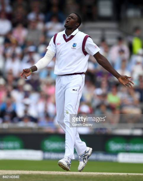 West Indies captain Jason Holder reacts after Kieron Powell drops Dawid Malan of England during day four of the 2nd Investec Test between England and...