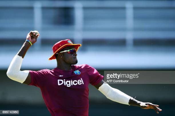 TOPSHOT West Indies' captain Jason Holder throws a ball during a practice session at the Queen's Park Oval in Port of Spain Trinidad on June 22 ahead...