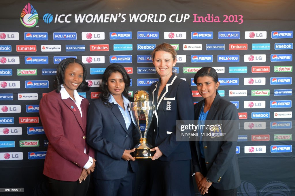 West Indies captain Merissa Aguilleira, India captain Mithali Raj, England captain Charlotte Edwards and Sri Lanka captain Shashikala Siriwardena pose with the ICC Women's World Cup 2013 trophy in Mumbai on January 27, 2013. Teams from Australia, England, New Zealand, Pakistan, South Africa, Sri Lanka, West Indies join hosts India for the global event which is being played from January 31 to February 17. AFP PHOTO/Indranil MUKHERJEE
