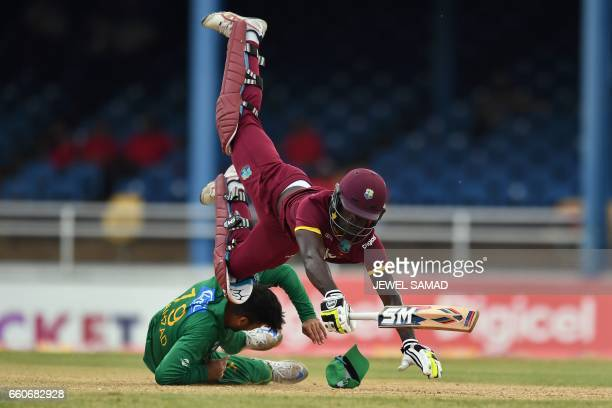 West Indies' Chadwick Walton collides with Pakistan's Ahmed Shehzad as he secures his wicket from a runout attempt during the second of fourT20Imatch...