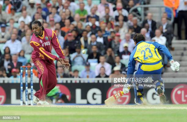 West Indies' Chris Gayle misfields whilst attempting to run out Sri Lanka's Tillakaratne Dilshan during the ICC World Twenty20 Semi Final at The Oval...