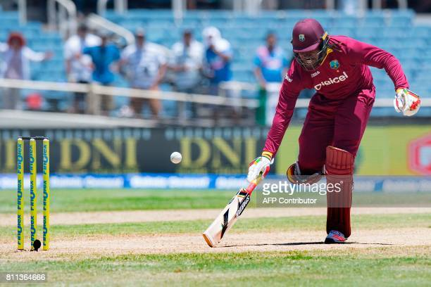 West Indies' Chris Gayle scores a run during the T20 match between West Indies and India at the Sabina Park Cricket Ground in Kingston Jamaica on...
