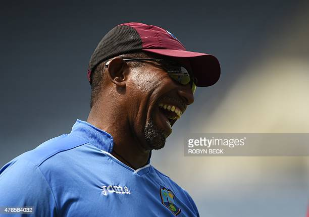 West Indies coach Phil Simmons laughs during a training session before the second cricket Test between Australia and the West Indies June 10 2015 at...