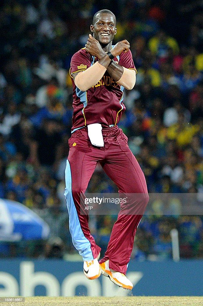West Indies cricket captain Darren Sammy celebrates the dismissal of Sri Lankan batsman Lahiru Thirimanne during the ICC Twenty20 Cricket World Cup's final match between Sri Lanka and West Indies at the R. Premadasa International Cricket Stadium in Colombo on October 7, 2012. AFP PHOTO/Ishara S. KODIKARA