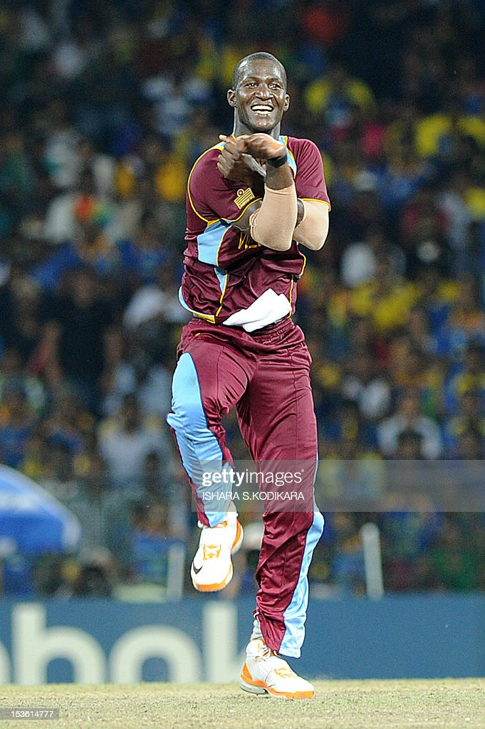 West Indies cricket captain Darren Sammy celebrates the dismissal of Sri Lankan cricket Lahiru Thirimanne during the ICC Twenty20 Cricket World Cup's final match between Sri Lanka and West Indies at the R. Premadasa International Cricket Stadium in Colombo on October 7, 2012. AFP PHOTO/Ishara S. KODIKARA