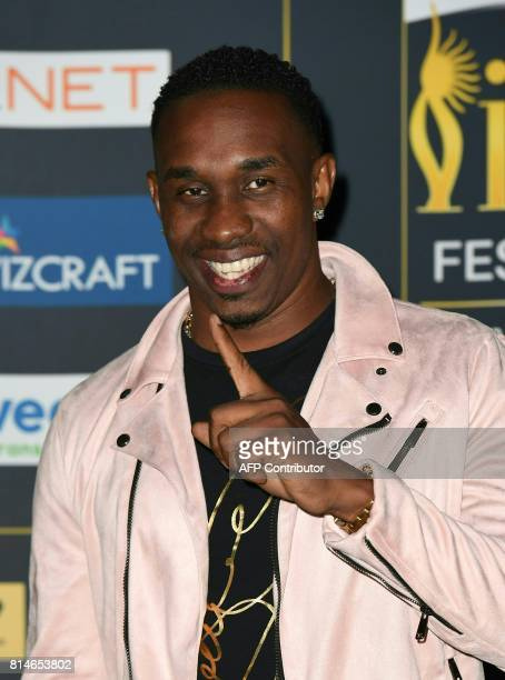 West Indies cricket player Dwayne Bravo arrives for IIFA Rocks July 14 2017 at the MetLife Stadium in East Rutherford New Jersey during the 18th...