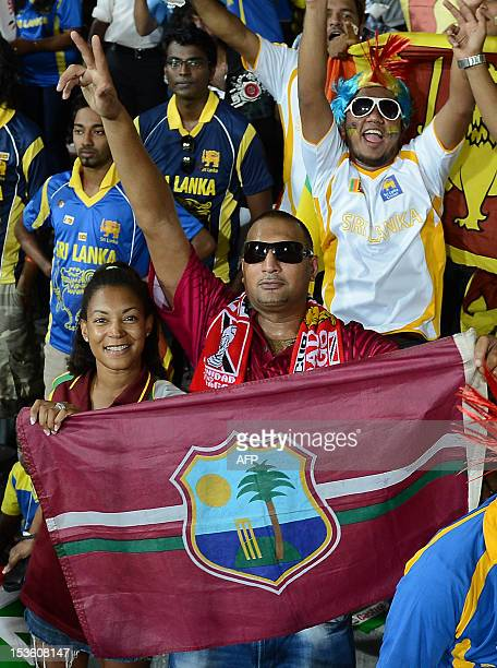 West Indies cricket supporters wave national flags ahead of the ICC Twenty20 Cricket World Cup's final match between Sri Lanka and West Indies at the...