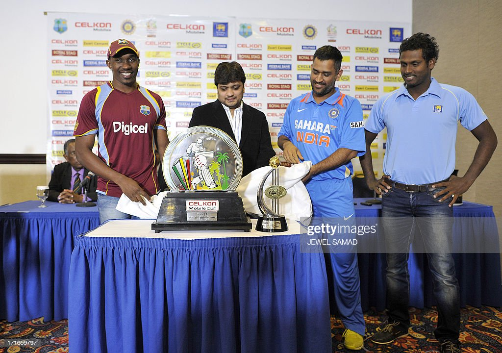 West Indies cricket team captain Dwayne Bravo, Celkon mobile India executive director Murali (only one name), Indian cricket team captain Mahendra Sing Dhoni and Sri Lankan cricket team captain Angelo Mathews unveil Celkon Tri-Nation series cup during a ceremony in Kingston on June 27, 2013. Sri Lanka will face West Indies in the first match of a Tri Nation series involving India also. AFP PHOTO/Jewel Samad