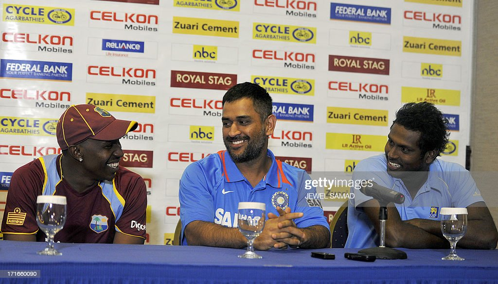 West Indies cricket team captain Dwayne Bravo, Indian cricket team captain Mahendra Sing Dhoni and Sri Lankan cricket team captain Angelo Mathews chats during an unveiling ceremony of Celkon Tri-Nation series cup in Kingston on June 27, 2013. Sri Lanka will face West Indies in the first match of a Tri Nation series involving India too. AFP PHOTO/Jewel Samad
