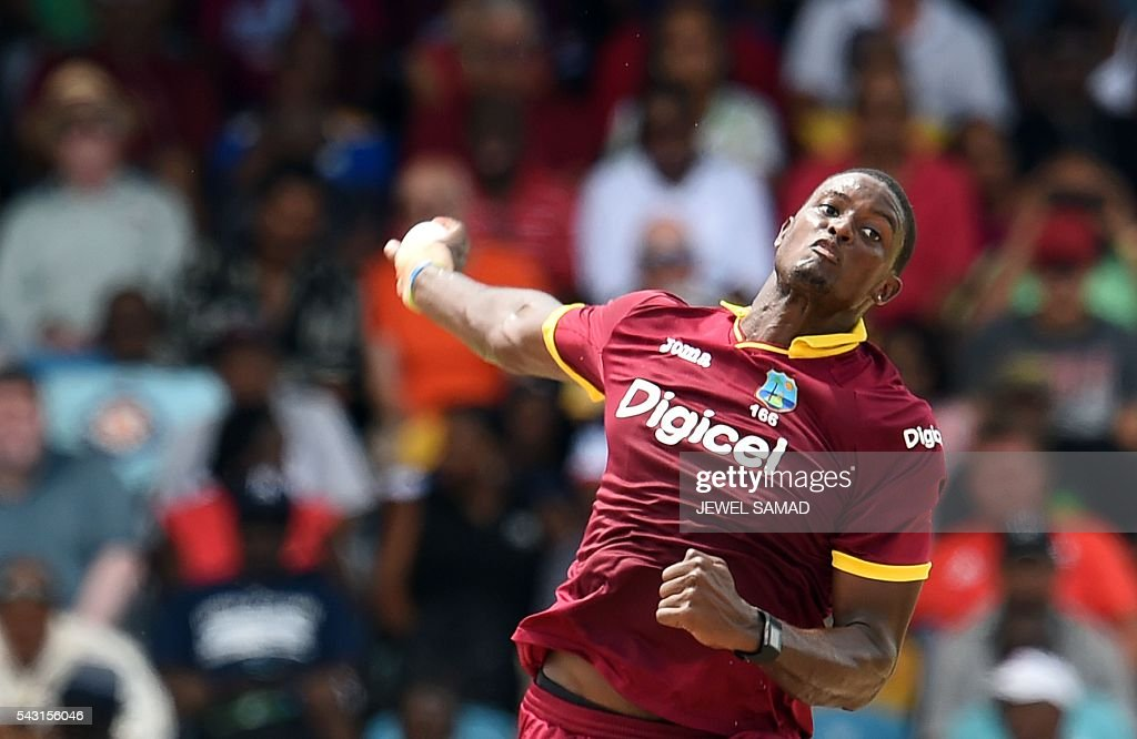 West Indies cricket team captain Jason Holder delivers a ball during the final match of the Tri-nation Series between Australia and West Indies in Bridgetown on June 26, 2016. / AFP / Jewel SAMAD