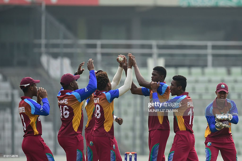 West Indies cricketer Alzarri Joseph (3rd R) celebrates after the dismissal of the Indian cricketer Anmolpreet Singh during the Under-19 World Cup cricket final between India and West Indies at the Sher-e-Bangla National Cricket Stadium in Dhaka on February 14, 2015. AFP PHOTO / Munir uz ZAMAN / AFP / MUNIR UZ ZAMAN
