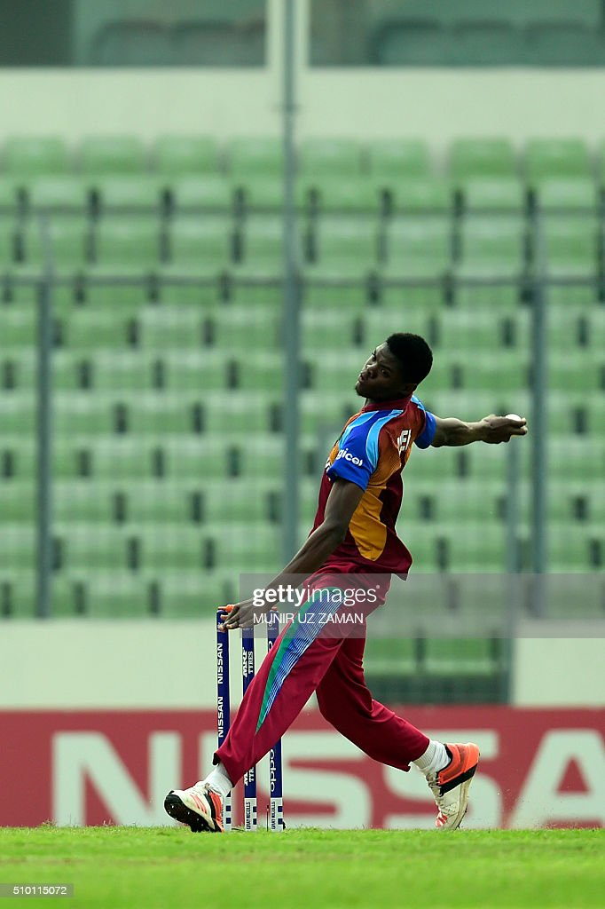 West Indies cricketer Alzarri Joseph delivers a ball during the Under-19 World Cup cricket final between India and West Indies at the Sher-e-Bangla National Cricket Stadium in Dhaka on February 14, 2015. AFP PHOTO / Munir uz ZAMAN / AFP / MUNIR UZ ZAMAN