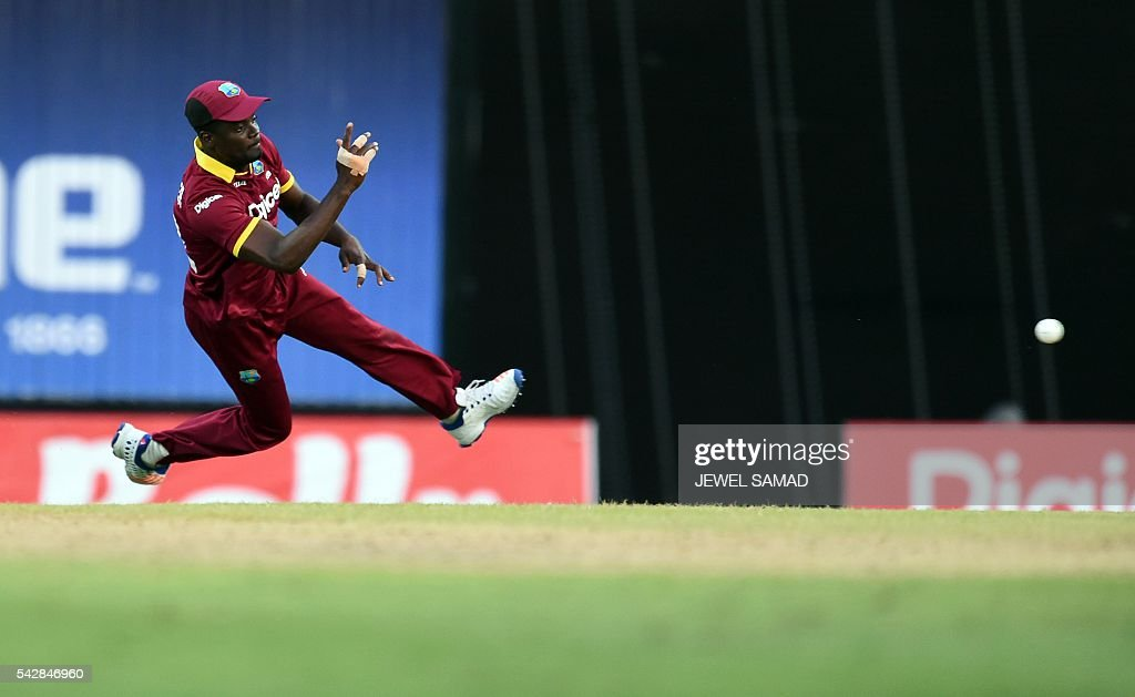 West Indies cricketer Andre Fletcher fields the ball during the 9th One Day International match of the Tri-nation Series between South Africa and West Indies at the Kensington Oval stadium in Bridgetown on June 24, 2016. / AFP / Jewel SAMAD