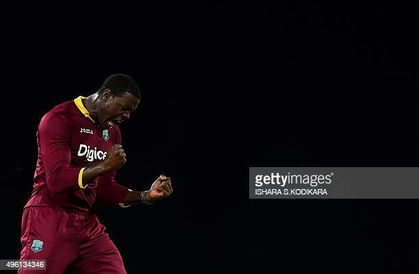 West Indies cricketer Carlos Brathwaite celebrates the wicket of Sri Lankan cricketer Tillakaratne Dilshan during the third and final One Day...