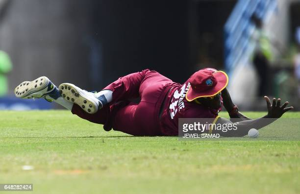 TOPSHOT West Indies cricketer Carlos Brathwaite dives to field the ball during the second of the threematch One Day International series between...