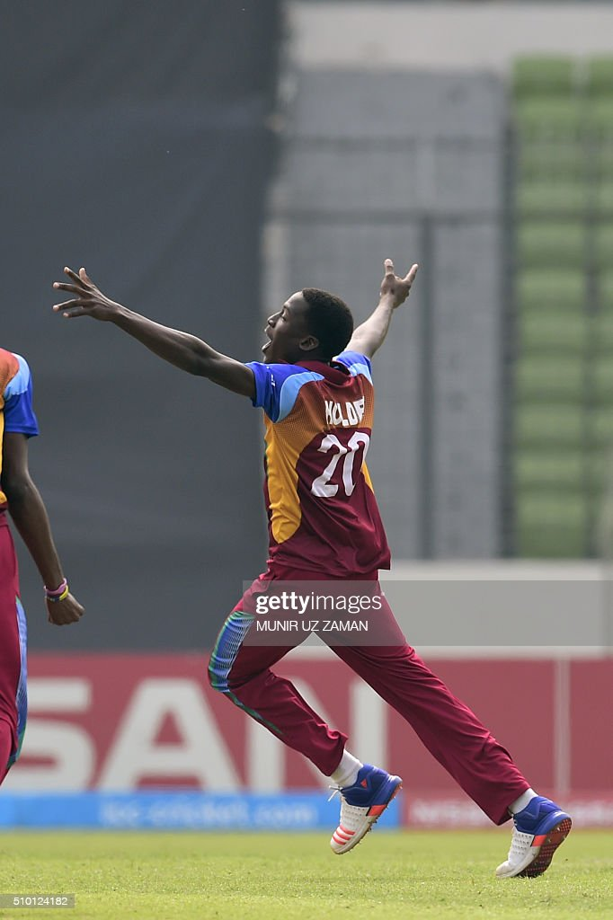 West Indies cricketer Chemar K Holder reacts after the dismissal of the Indian cricketer Mahipal Lomror (R) during the under-19s World Cup cricket final between India and West Indies at the Sher-e-Bangla National Cricket Stadium in Dhaka on February 14, 2016. AFP PHOTO/Munir uz ZAMAN / AFP / MUNIR UZ ZAMAN