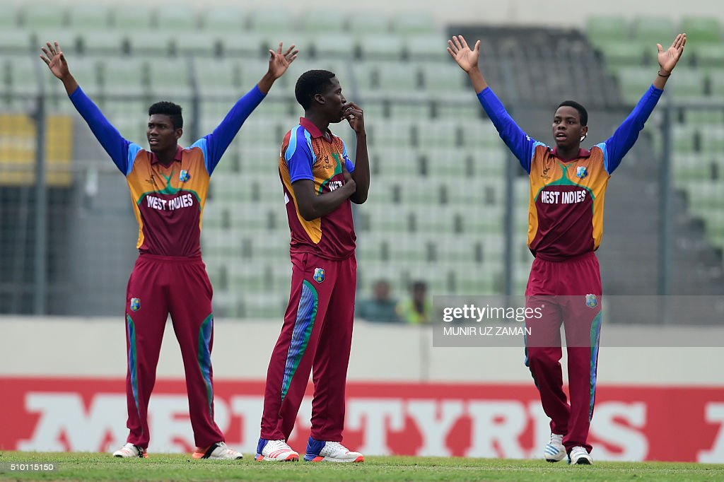 West Indies cricketer Chemar K Holder (C) reacts during the Under-19 World Cup cricket final between India and West Indies at the Sher-e-Bangla National Cricket Stadium in Dhaka on February 14, 2015. AFP PHOTO / Munir uz ZAMAN / AFP / MUNIR UZ ZAMAN