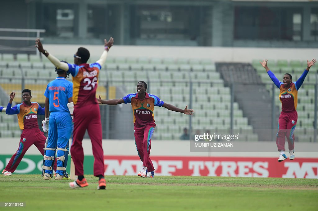 West Indies cricketer Chemar K Holder (2nd R) unsuccessfully appeals for a Leg Before Wicket (LBW) decision during the Under-19 World Cup cricket final between India and West Indies at the Sher-e-Bangla National Cricket Stadium in Dhaka on February 14, 2015. AFP PHOTO / Munir uz ZAMAN / AFP / MUNIR UZ ZAMAN