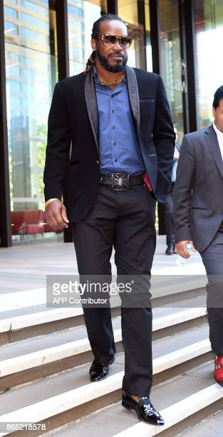 West Indies cricketer Chris Gayle leaves the New South Wales Supreme Court in Sydney on October 23 2017 Gayle has denied exposing his genitals to a...