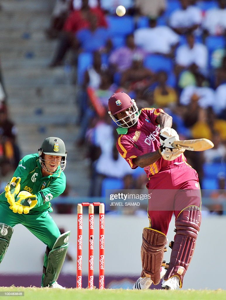 West Indies cricketer Dale Richards hits a boundary as South African wicketkeeper AB de Villiers (L) looks on during the second One Day International match between West Indies and South Africa at the Sir Vivian Richards Stadium in St John's on May 24, 2010. Batting first, South Africa scored 300-runs at the end of their innings. AFP PHOTO/Jewel Samad