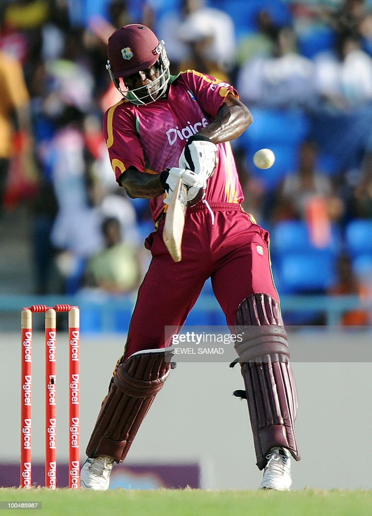 West Indies cricketer Darren Sammy hits a boundary during the second One Day International match between West Indies and South Africa at the Sir Vivian Richards Stadium in St John's on May 24, 2010. Batting first, South Africa scored 300-runs at the end of their innings. AFP PHOTO/Jewel Samad