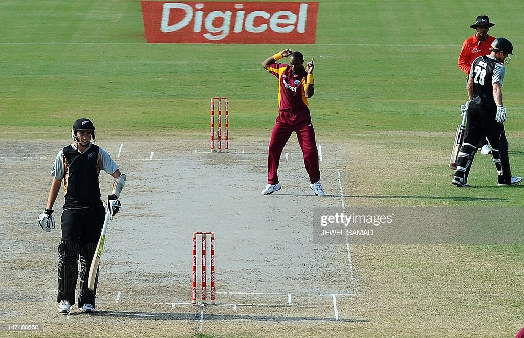 West Indies cricketer Dwayne Bravo dances to celebrate dismissing New Zealand's batsman Rob Nicol during the first T20 match between West Indies and...