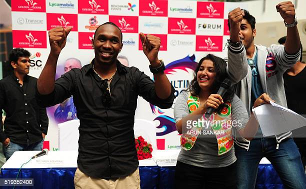 West Indies cricketer Dwayne Bravo dances with fans at the launch of the 'Ultimate Sports Coaching' cricket camp in Chennai on April 6 2016 The West...