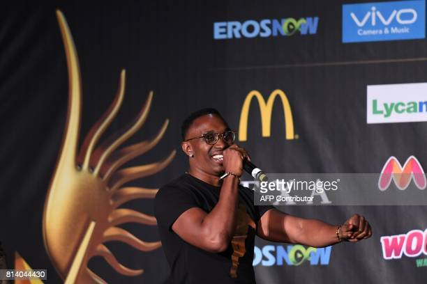 West Indies cricketer Dwayne Bravo sings during a press conference ahead of the 18th International Indian Film Academy Festival in New York City July...