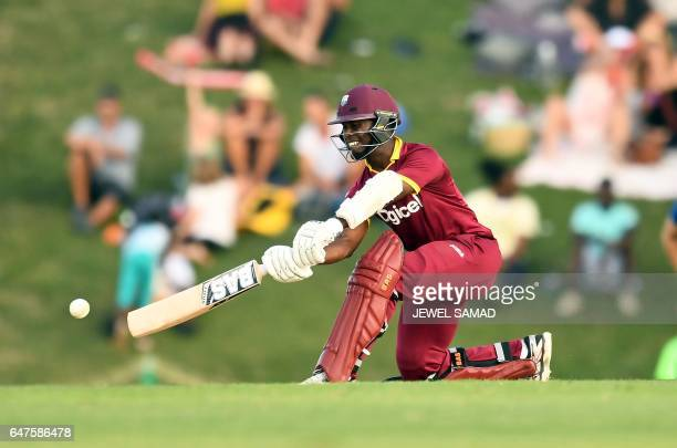 TOPSHOT West Indies cricketer Jason Mohammed plays a shot during the One Day International match between England and West Indies at the Sir Vivian...
