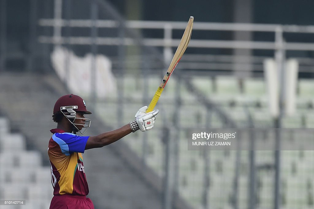 West Indies cricketer Keacy Carty acknowledges the crowd after scoring a half-century (50 runs) during the Under-19 World Cup cricket final between India and West Indies at the The Sher-e-Bangla National Cricket Stadium in Dhaka on February 14, 2016. AFP PHOTO / Munir uz ZAMAN / AFP / MUNIR UZ ZAMAN