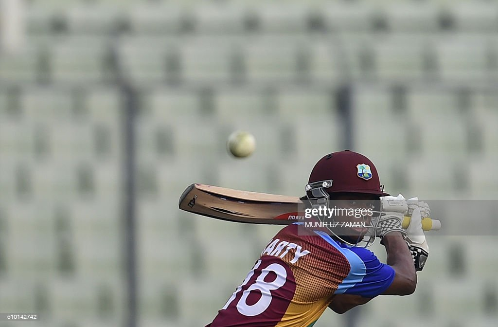 West Indies cricketer Keacy Carty plays a shot during the Under-19 World Cup cricket final between India and West Indies at the The Sher-e-Bangla National Cricket Stadium in Dhaka on February 14, 2016. AFP PHOTO / Munir uz ZAMAN / AFP / MUNIR UZ ZAMAN