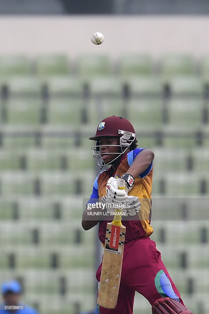 West Indies cricketer Keacy Carty plays a shot during the under-19s World Cup cricket final between India and West Indies at the Sher-e-Bangla National Cricket Stadium in Dhaka on February 14, 2016. AFP PHOTO/Munir uz ZAMAN / AFP / MUNIR UZ ZAMAN