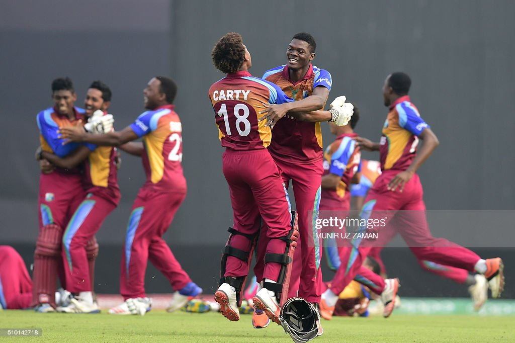 West Indies cricketer Keacy Carty (C) reacts after winning the Under-19 World Cup cricket final between India and West Indies at the The Sher-e-Bangla National Cricket Stadium in Dhaka on February 14, 2016. AFP PHOTO / Munir uz ZAMAN / AFP / MUNIR UZ ZAMAN