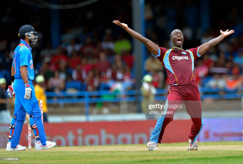 West Indies cricketer Kemar Roach (R) unsuccessfully appeals for a dismissal against Indian cricket team captain Virat Kohli during the fourth match of the Tri-Nation series between India and West Indies at the Queen's Park Oval in Port of Spain on July 5, 2013. West Indies won the toss and elected to field. AFP PHOTO/Jewel Samad