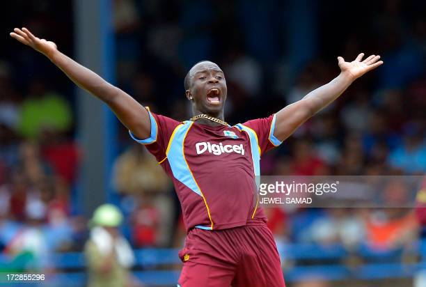 West Indies cricketer Kemar Roach unsuccessfully appeals for a dismissal against Indian cricket team captain Virat Kohli during the fourth match of...