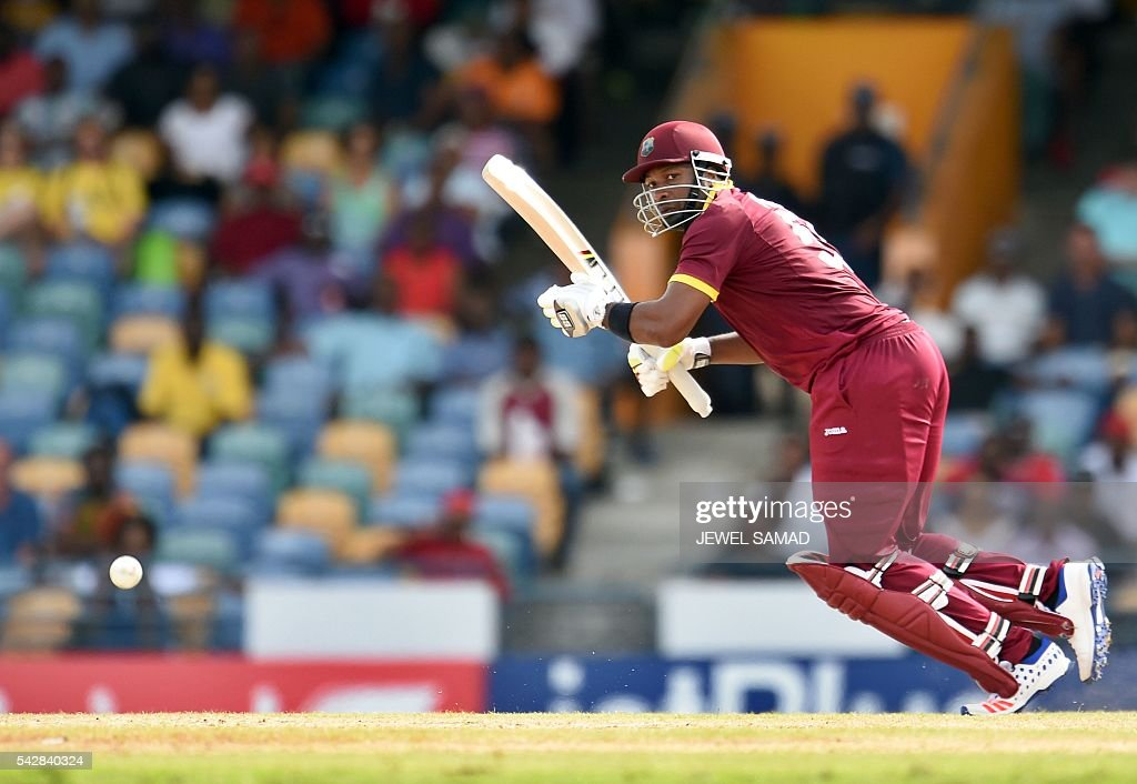West Indies cricketer Kieron Pollard plays a shot during the 9th One Day International match of the Tri-nation Series between South Africa and West Indies at the Kensington Oval stadium in Bridgetown on June 24, 2016. / AFP / JEWEL
