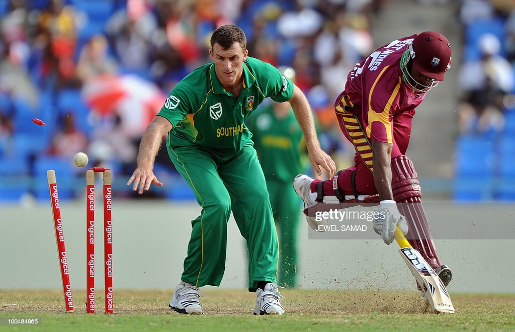 West Indies cricketer Kieron Pollard (R) saves his wicket as South African bowler Ryan McLaren watches during the second One Day International match between West Indies and South Africa at the Sir Vivian Richards Stadium in St John's on May 24, 2010. Batting first, South Africa scored 300-runs at the end of their innings. AFP PHOTO/Jewel Samad