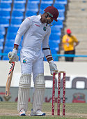 West Indies cricketer Marlon Samuels adjusts the bails during day four of the 1st test cricket match between West Indies and India on July 24 2016 at...