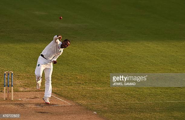 West Indies cricketer Marlon Samuels delivers a ball during day two of the second Test cricket match between the West Indies and England at the...