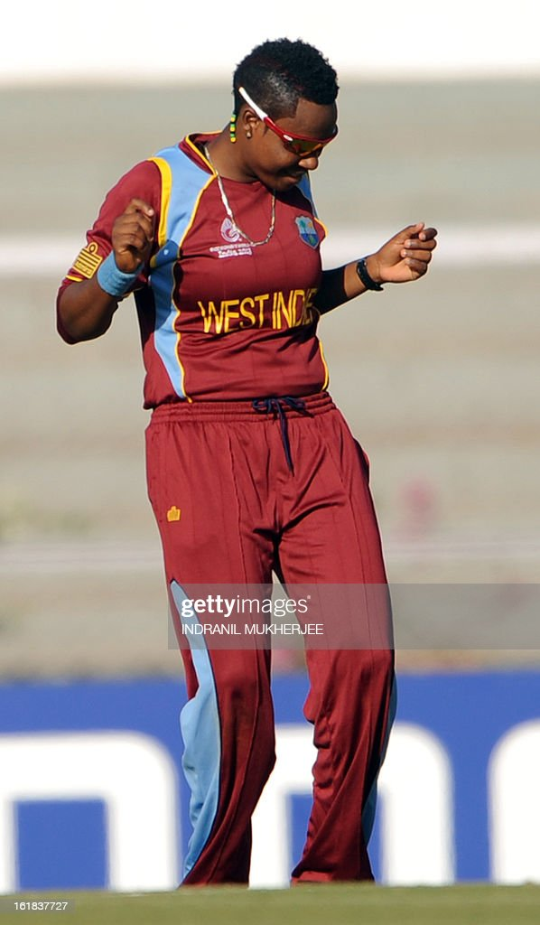 West Indies cricketer Natasha McLean dances after the wicket of unseen Australian cricketer Jess Cameron during the final match of the ICC Women's World Cup 2013 between Australia and West Indies at the Cricket Club of India's Brabourne stadium in Mumbai on February 17, 2013. AFP PHOTO/Indranil MUKHERJEE