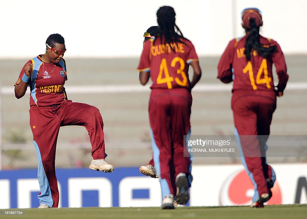 West Indies cricketer Natasha McLean (L) dances after the wicket of unseen Australian cricketer Jess Cameron during the final match of the ICC Women's World Cup 2013 between Australia and West Indies at the Cricket Club of India's Brabourne stadium in Mumbai on February 17, 2013. AFP PHOTO/Indranil MUKHERJEE