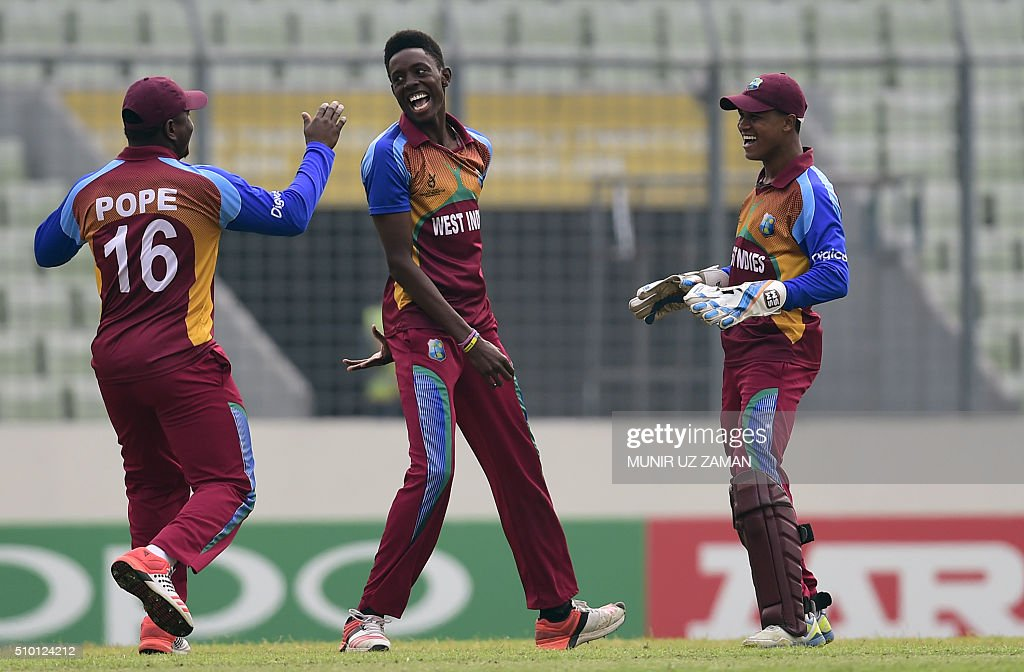 West Indies cricketer Shamar Springer (c) celebrates after the dismissal of the Indian cricketer Armaan Jaffer during the under-19s World Cup cricket final between India and West Indies at the Sher-e-Bangla National Cricket Stadium in Dhaka on February 14, 2016. AFP PHOTO/Munir uz ZAMAN / AFP / MUNIR UZ ZAMAN