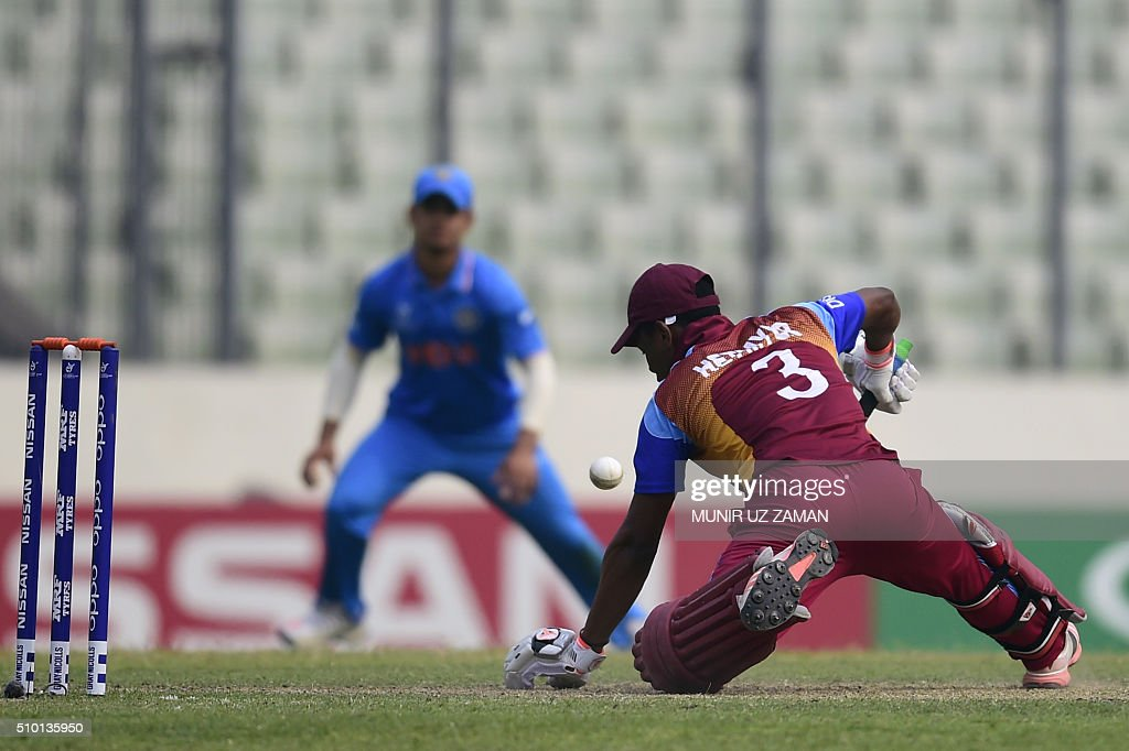 West Indies cricketer Shimron Hetmyer plays a shot during the under-19s World Cup cricket final between India and West Indies at the Sher-e-Bangla National Cricket Stadium in Dhaka on February 14, 2016. AFP PHOTO/Munir uz ZAMAN / AFP / MUNIR UZ ZAMAN