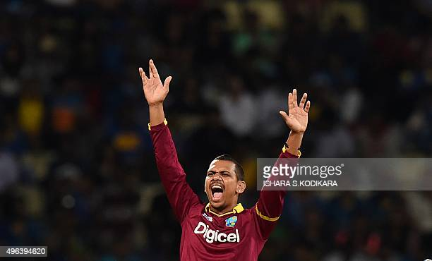 West Indies cricketer Sunil Narine successfully appeals for a Leg Before Wicket decision against Sri Lankan cricketer Tillakaratne Dilshan during the...